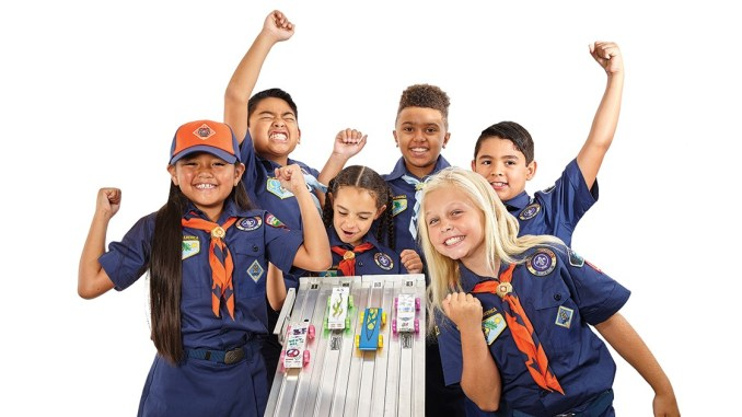Cub Scouts cheering for pinewood derby race