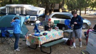 Family camping meal preparation in the RV area