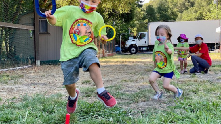 Young cub scouts at play during Day Camp.